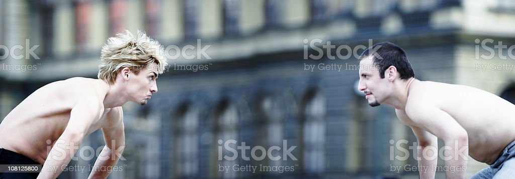 Two Shirtless Young Men Ready to Fight royalty-free stock photo