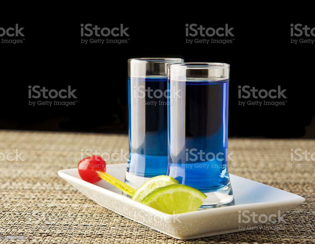 Two shots of blue kamikaze drink stock photo