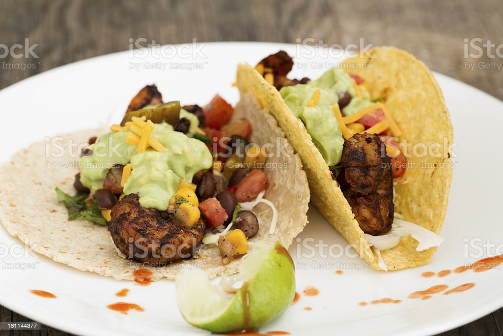 Two Shrimp Tacos On A White Plate royalty-free stock photo