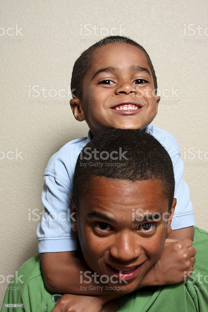 Two Siblings Rough-Housing royalty-free stock photo