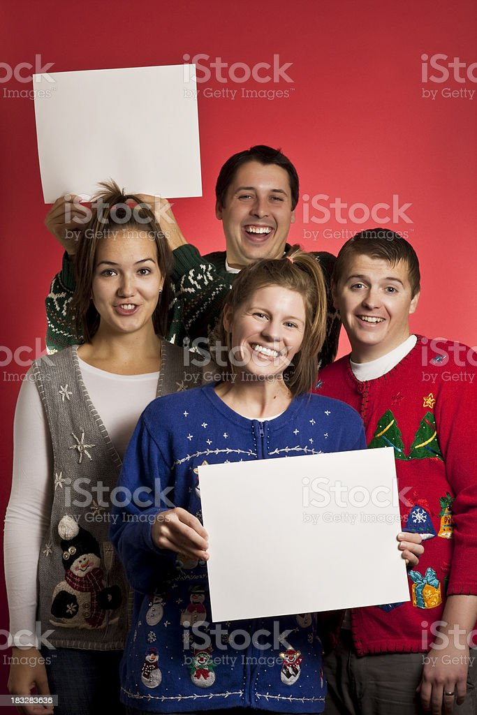 Two signs Christmas sweater group royalty-free stock photo