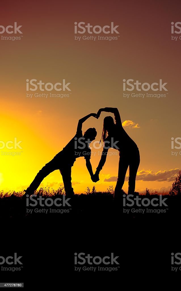 Two silhouette at sunset,, a declaration of love stock photo