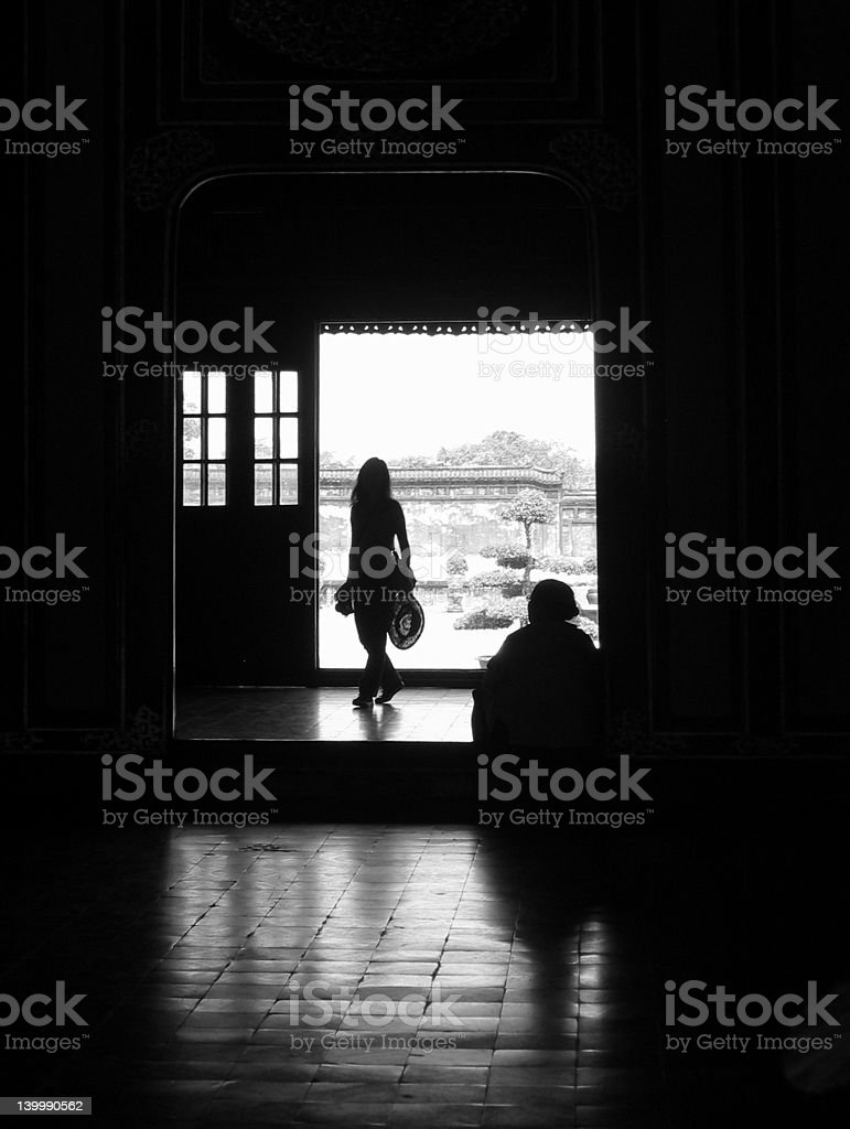 Two silhouettes under doorway royalty-free stock photo