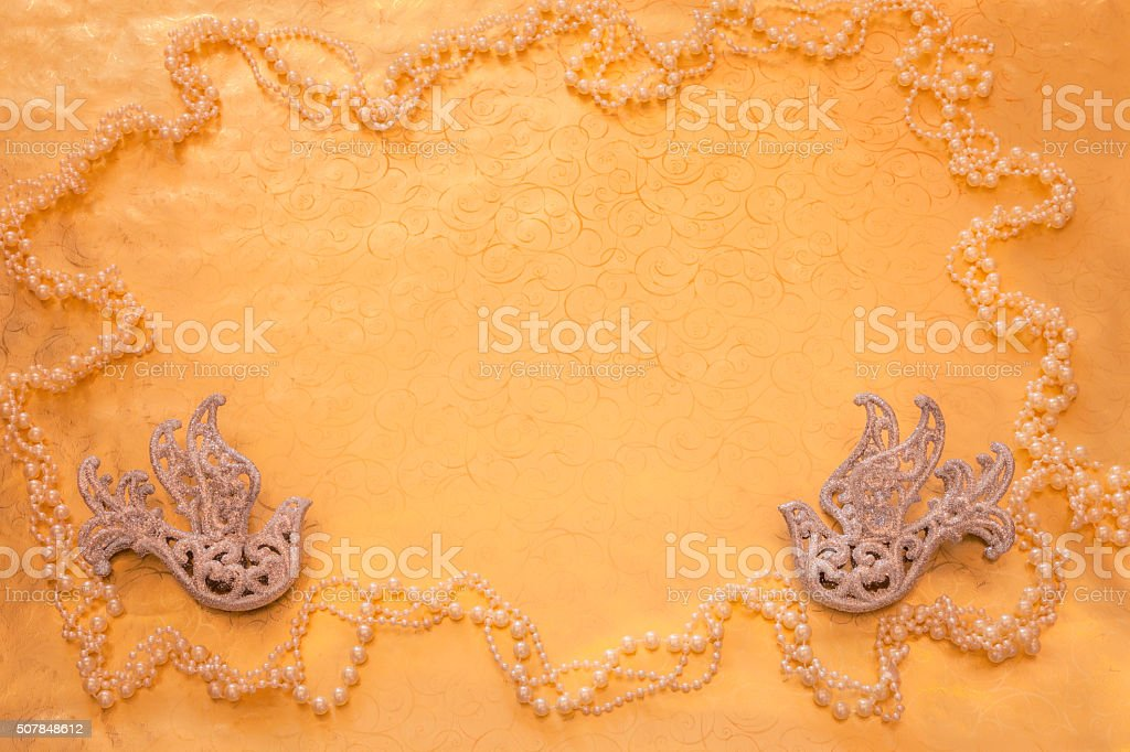 Two silver glittered doves on gold with pearls background (P) stock photo