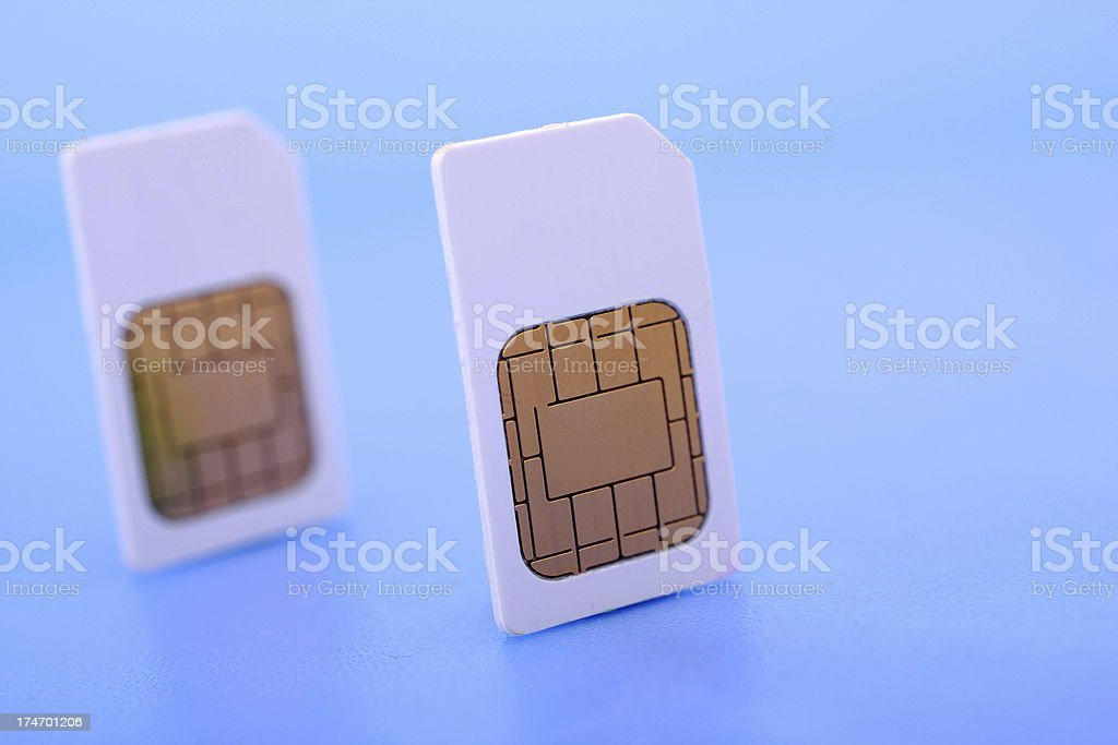 Two SIM cards on blue background stock photo