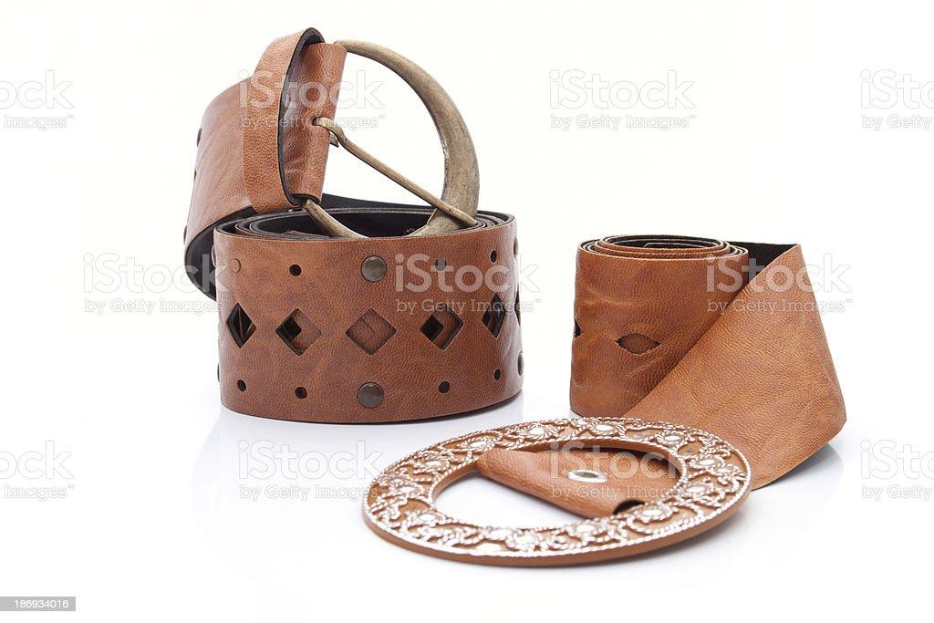 Two similar Lady's leather stylish belt royalty-free stock photo