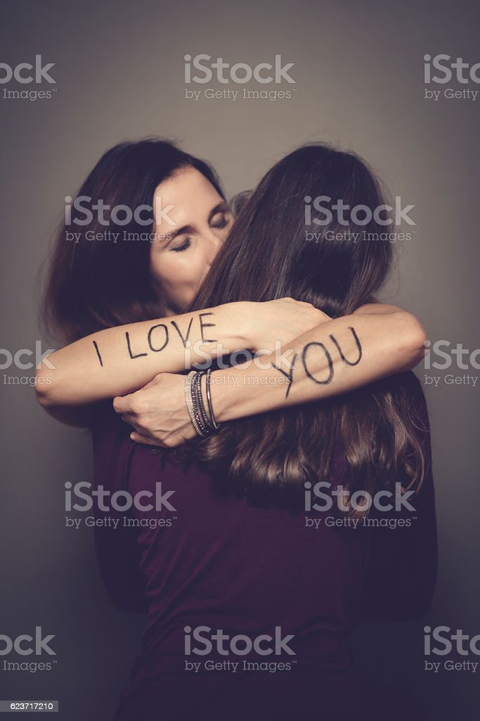 two Sister hugging stock photo