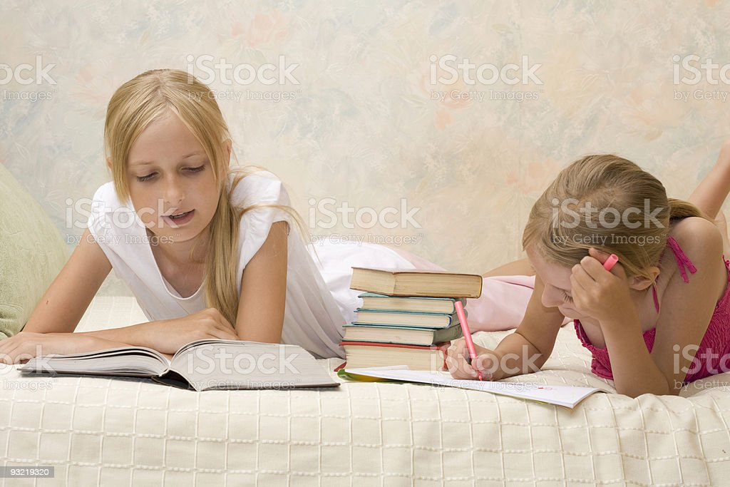 Two sisters do homework royalty-free stock photo