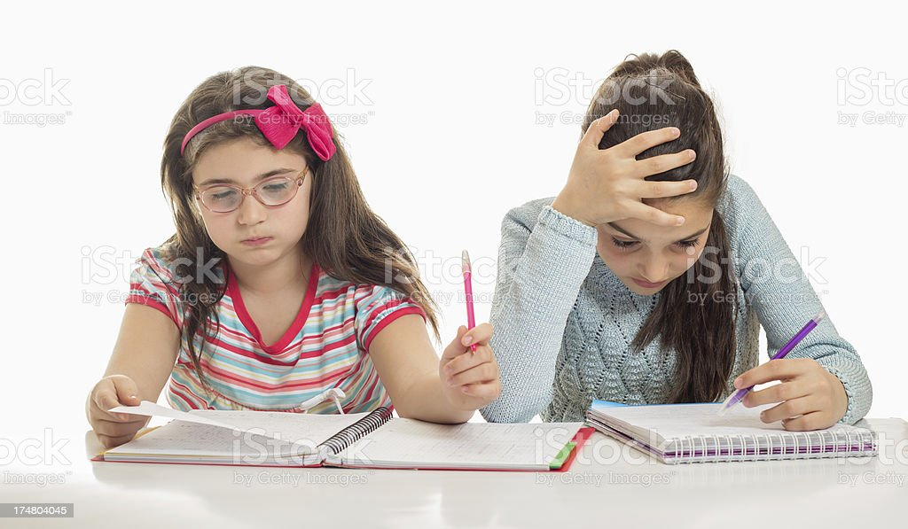 Two sisters doing homework - frustrated royalty-free stock photo