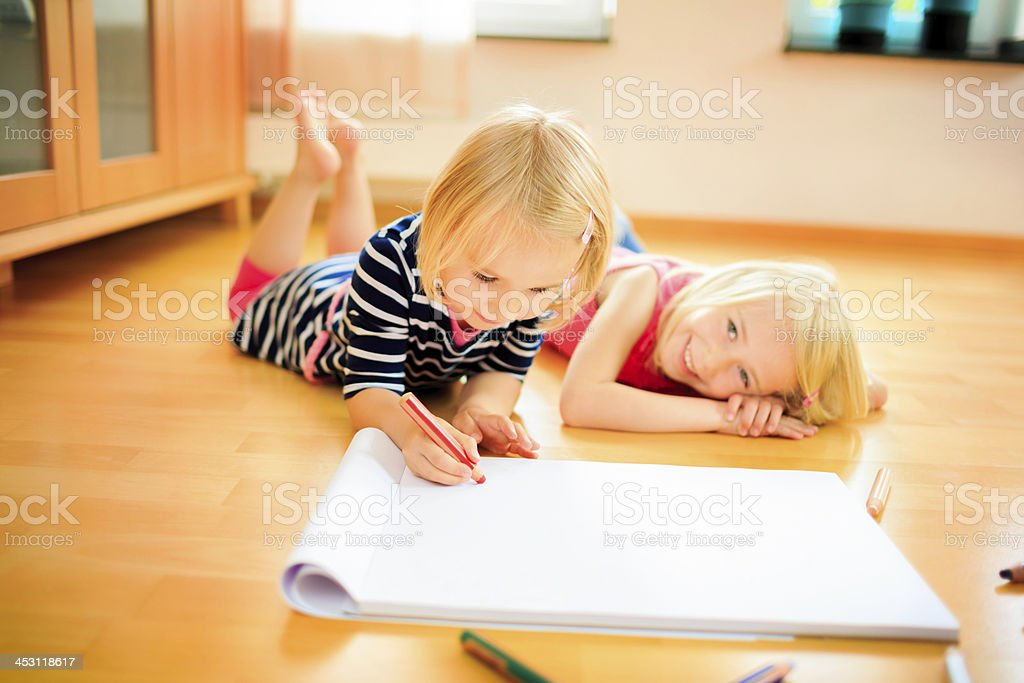 Two sisters having fun painting royalty-free stock photo