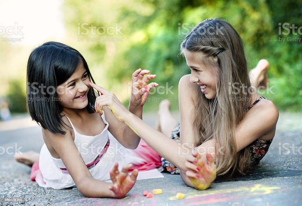 Two sisters having fun stock photo