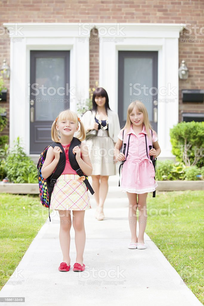 two sisters heading back to school stock photo