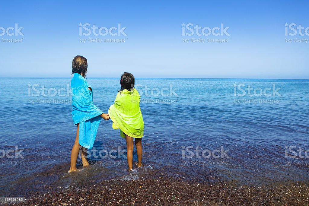 Two sisters looking the sea royalty-free stock photo
