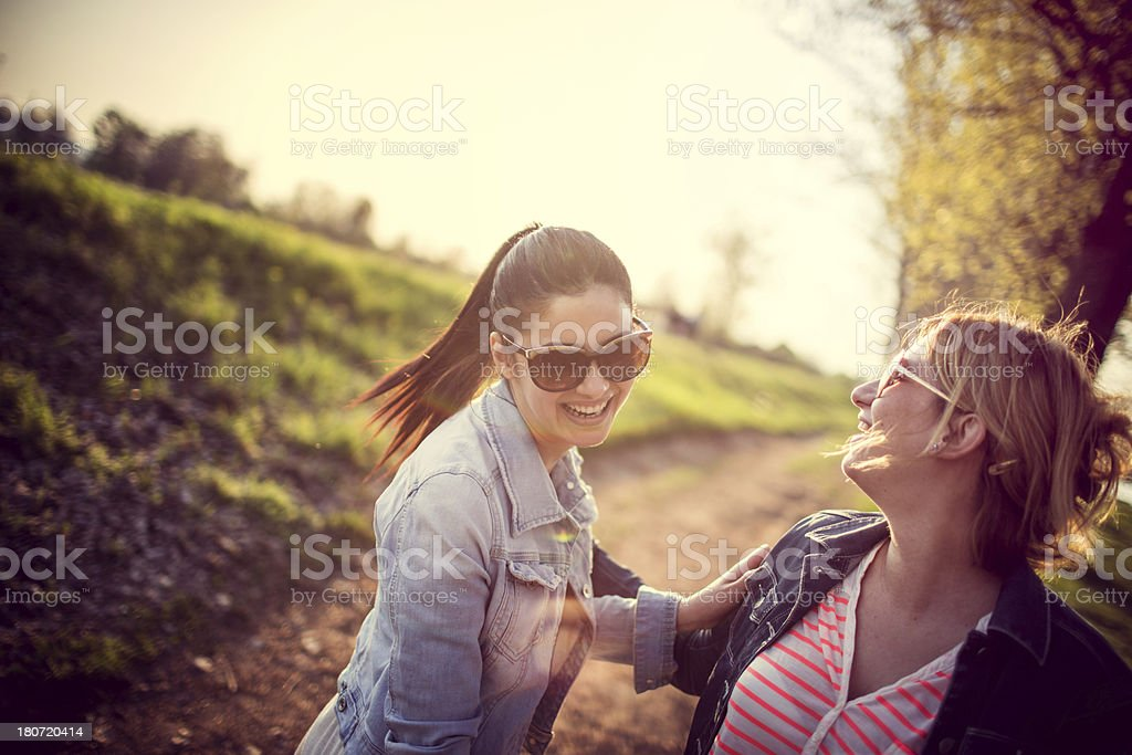 Two sisters smiling on the outdoors royalty-free stock photo