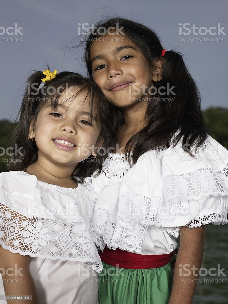Two sisters (4-7) smiling, portrait royalty-free stock photo