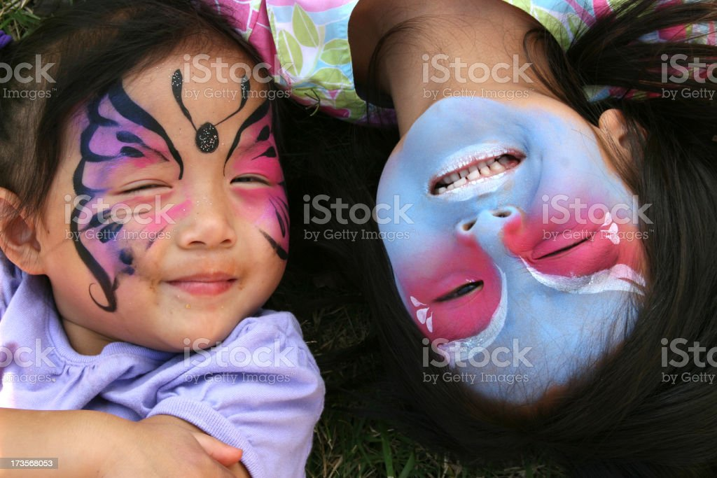 Two sisters with their faces painted royalty-free stock photo