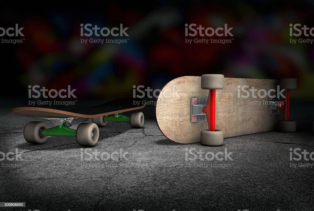 Two skateboards lying on concrete floor stock photo