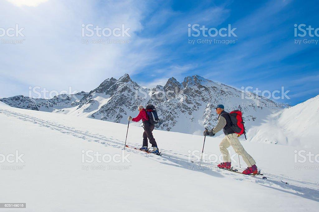 Two ski mountaineers men stock photo
