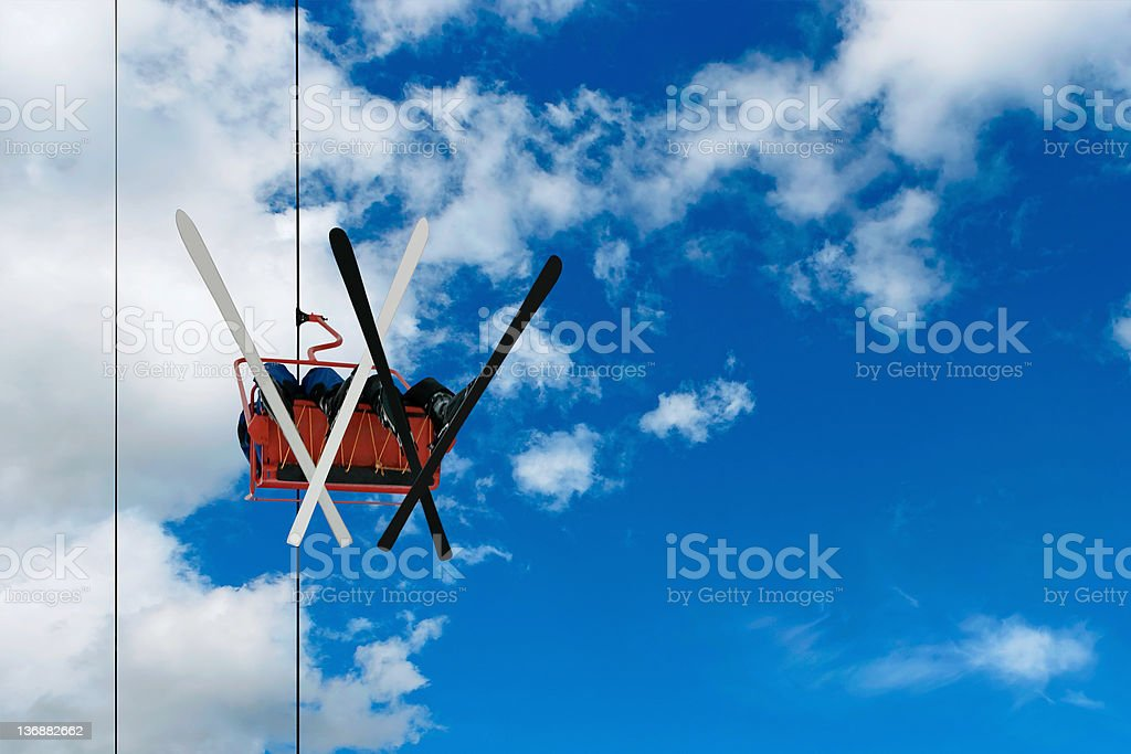 two skiers on a chairlift royalty-free stock photo