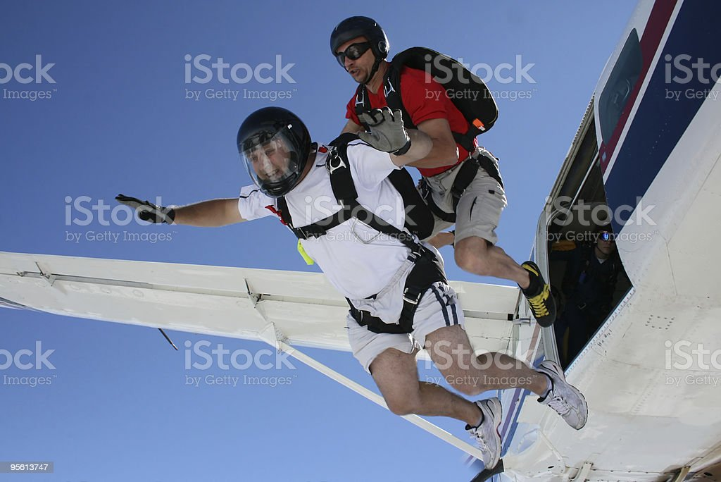 Two Skydivers exit a airplane royalty-free stock photo