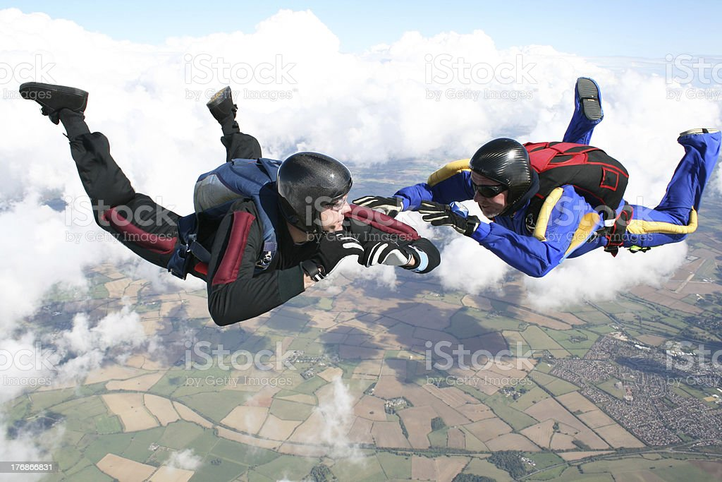 Two skydivers in freefall stock photo