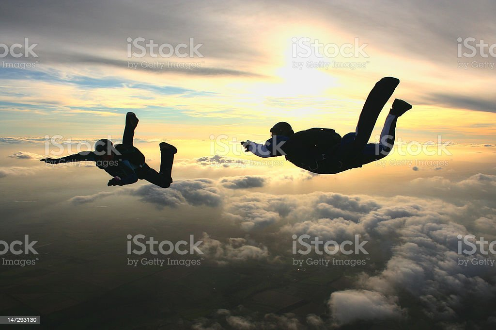 Two skydivers practise formation flying stock photo
