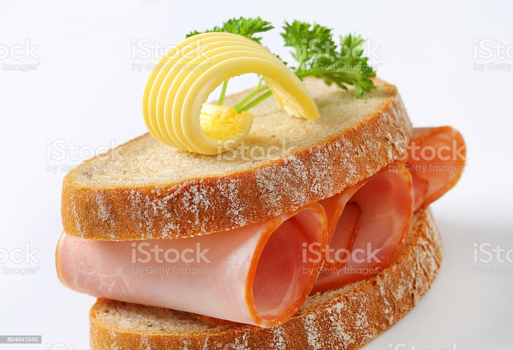 Two slices of bread with ham stock photo