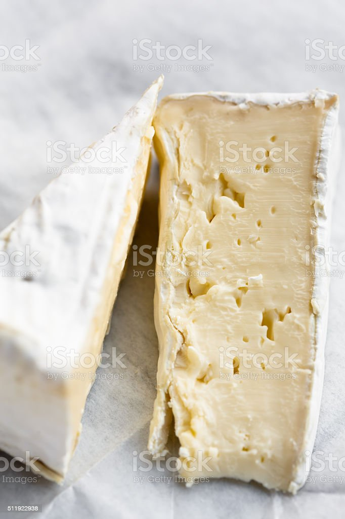 Two slices of Brie stock photo