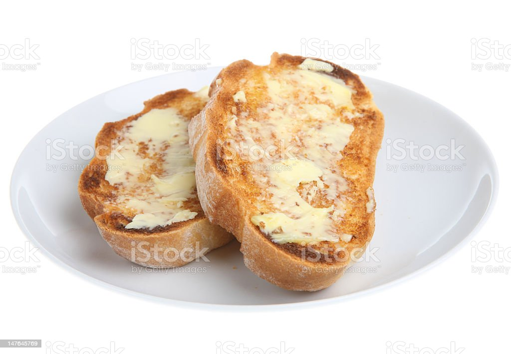 Two slices of buttered toast on a white plate stock photo