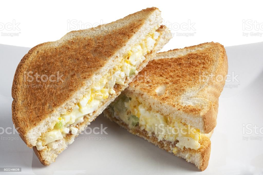 two slices of egg salad sandwich stock photo