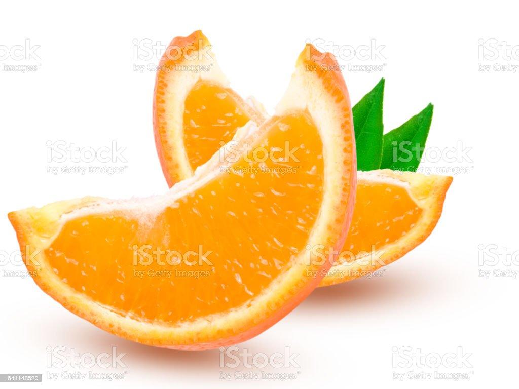 Two slices of orange tangerine or Mineola with leaf isolated on white background stock photo