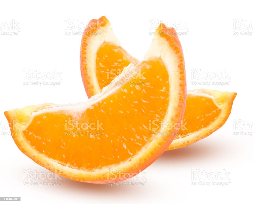 Two slices of orange tangerine with leaves isolated on white background stock photo