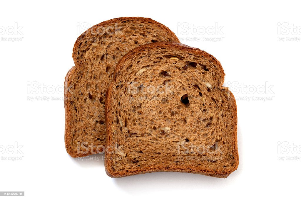 Two slices of wholewheat bread on white background stock photo