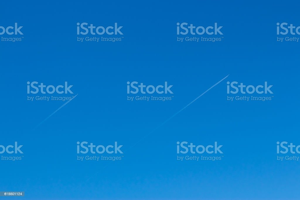 Two small aircraft flying parallel and reverse trace of them stock photo