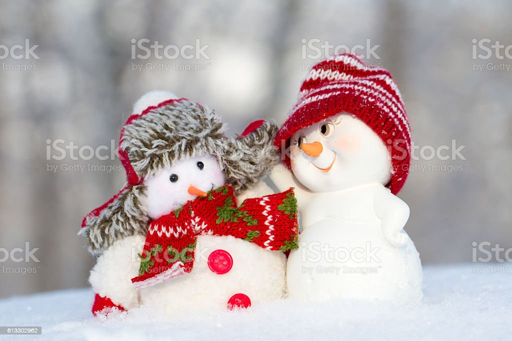 two small cheerful snowman stock photo