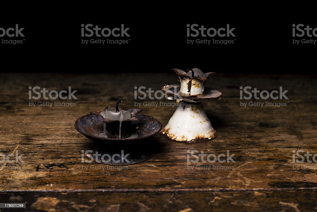 Two small rusty antique candle sticks royalty-free stock photo