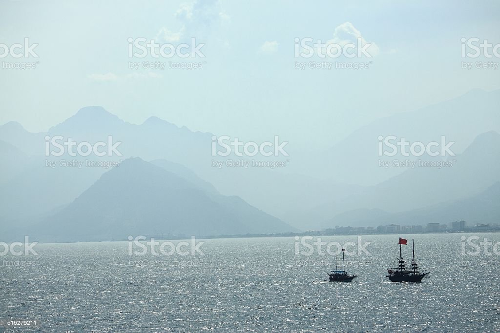 two small ships in the sea stock photo