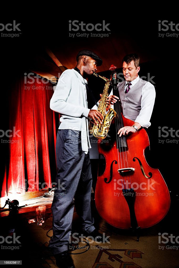 Two smartly dressed men playing a Jazz duet stock photo