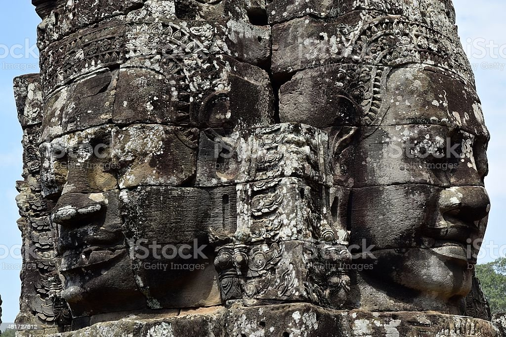 Two Smiling Buddha Faces at Angkor stock photo
