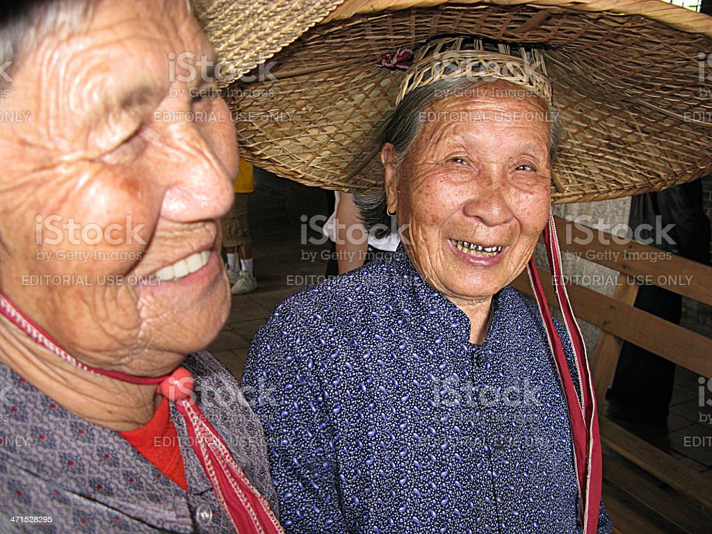 Two Smiling Chinese Women in Local Costume stock photo