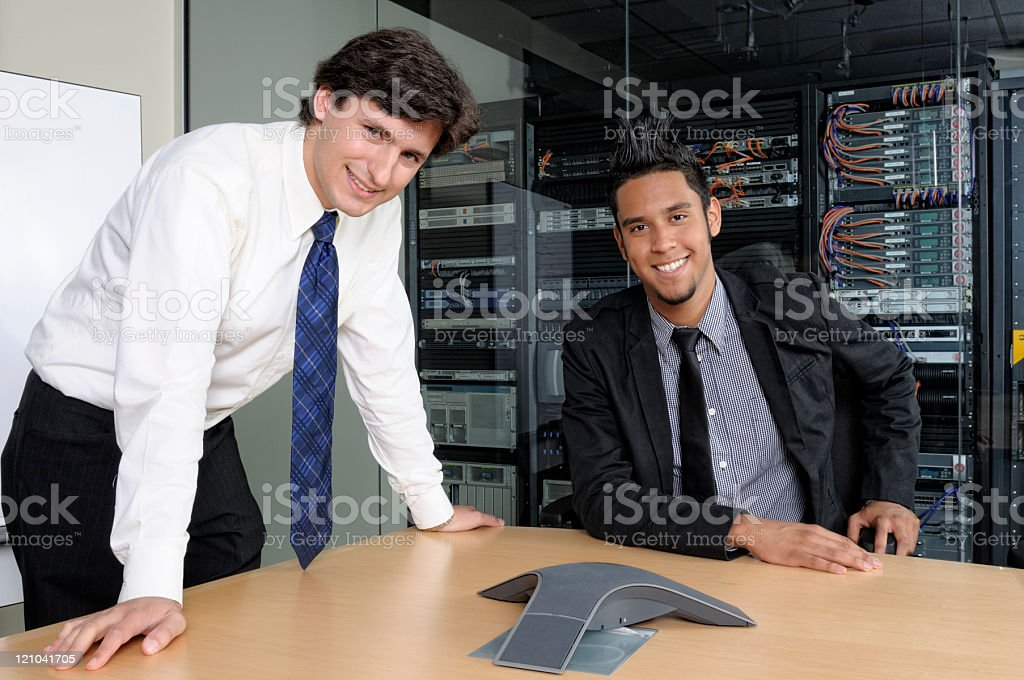 Two smiling corrupt businessmen royalty-free stock photo
