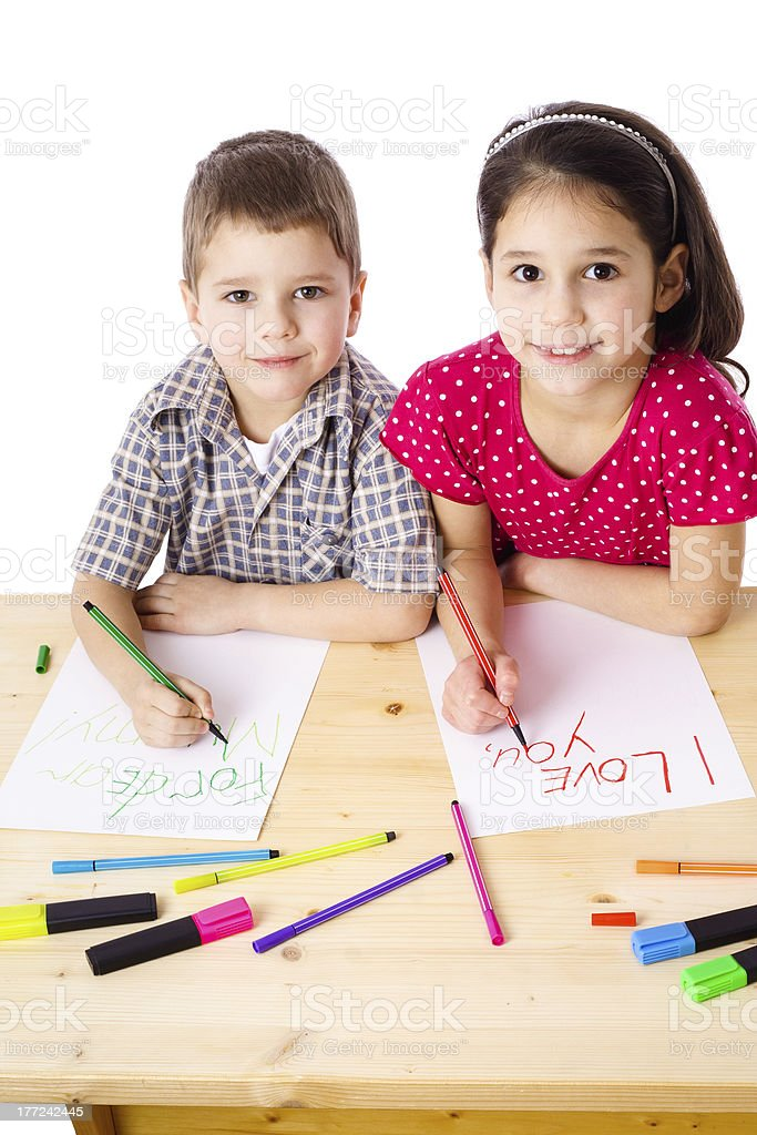 Two smiling kids draw for mum royalty-free stock photo