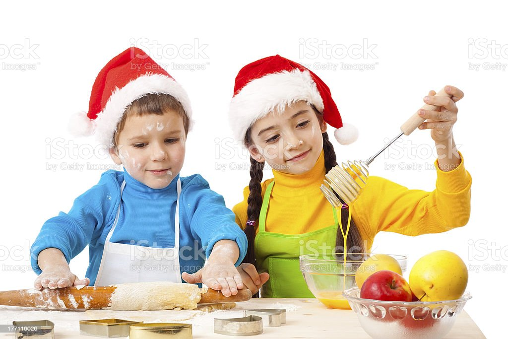 Two smiling kids with Christmas cooking royalty-free stock photo
