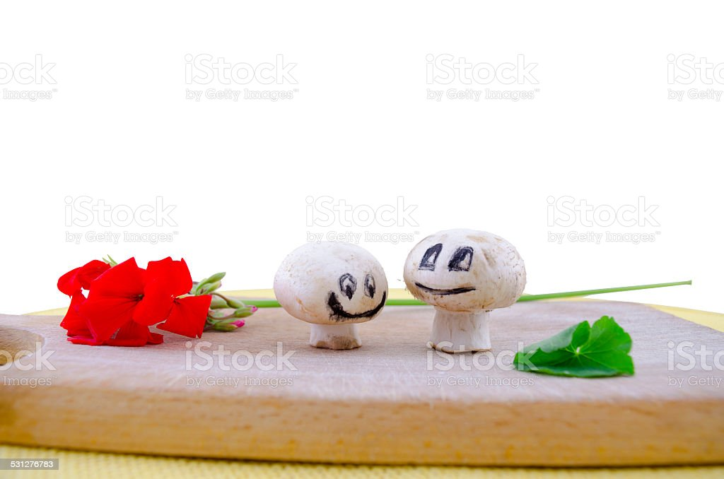 Two smiling mushrooms falling in love isolated on white royalty-free stock photo