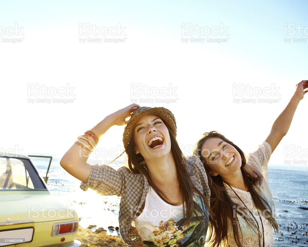 Two smiling young women beside royalty-free stock photo