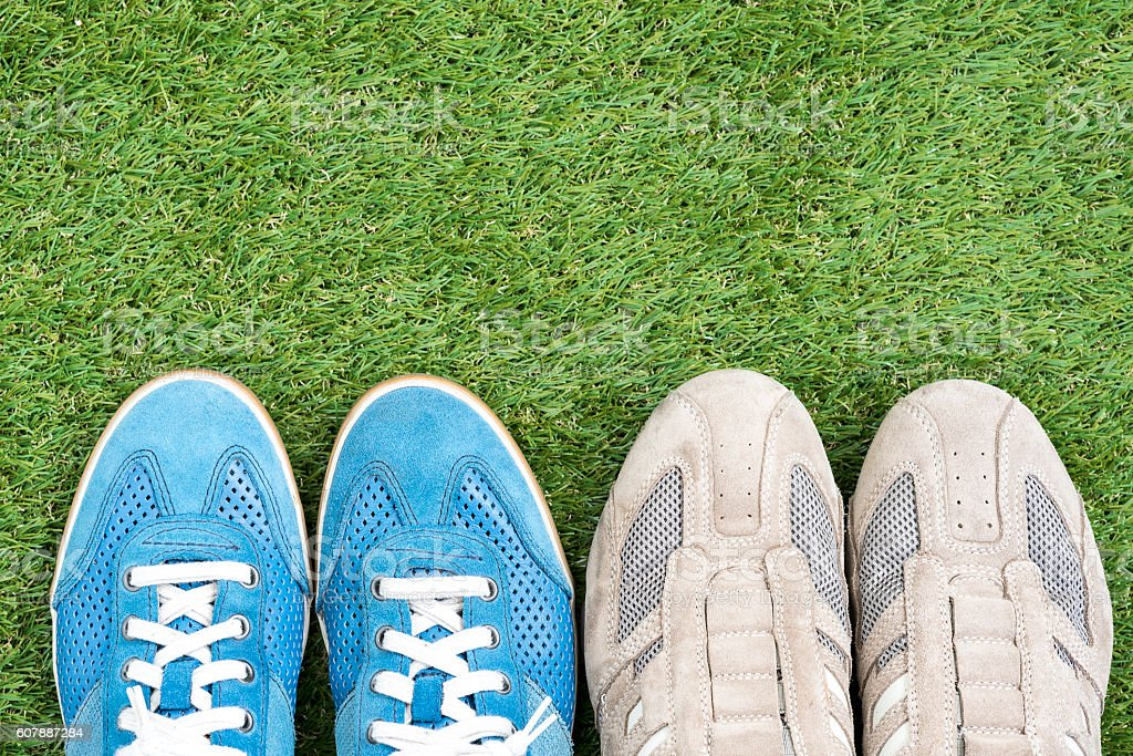two sneaker leather shoes over green grass field stock photo