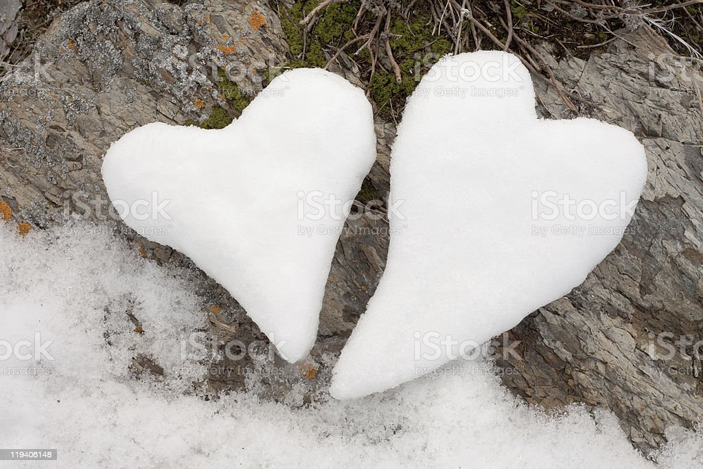 Two snow hearts on rock royalty-free stock photo