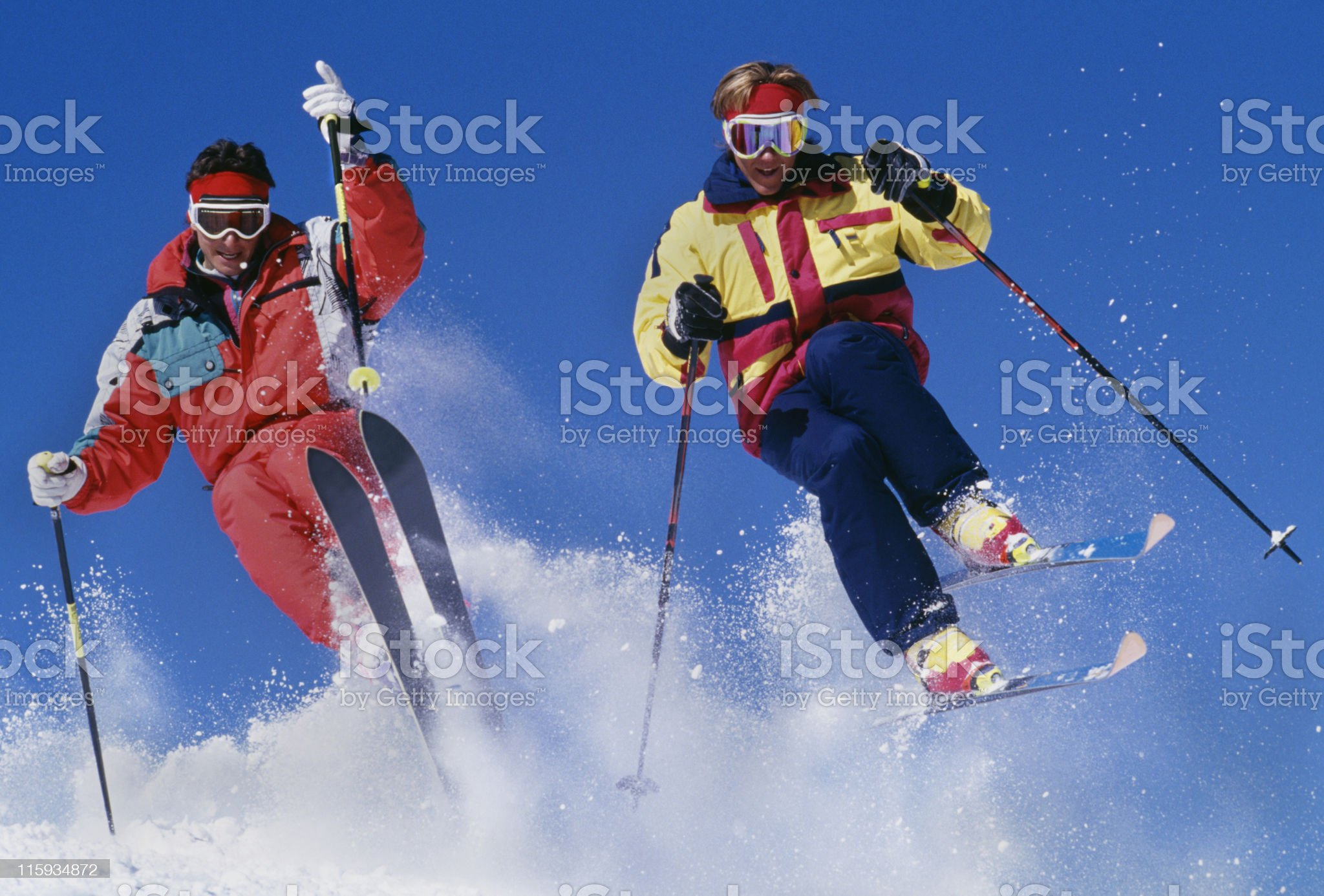 Two Snow Skiers Jumping Against Blue Sky royalty-free stock photo