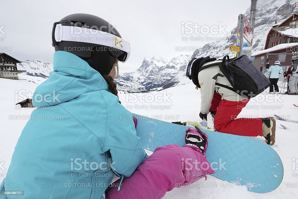 Two snowboarders getting ready in Alps royalty-free stock photo