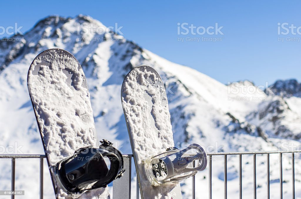 two snowboarding tables snow mountain supported railing stock photo